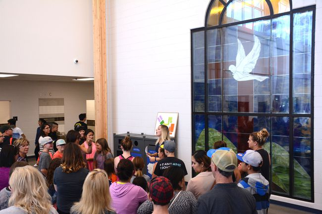 A tour group is shown a stained glass at the new École St. Joseph School on Sept. 5. The window is originally from their old library (Peter Shokeir | Whitecourt Star).