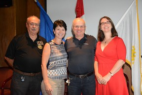 From the left, local Rotary district assistant governor Ed Holtner, Rotary Foundation chair Nevis Prufer, charter member Arnie Olexan and acting president Holly Astill pose together during the Whitecourt Rotary Club meeting at Ritz Cafe and Motor Inn on Sept.  7 (Peter Shokeir | Whitecourt Star).