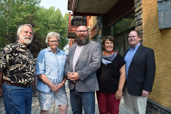 From left, Canmore mayor John Borrowman, councillor Esme Comfort, Minister of Municipal Affairs Shaye Anderson, Canmore councillor Joanna McCallum, and Banff-Cochrane MLA Cam Westhead at the Interagency BBQ during Anderson's visit to the Bow Valley Sept. 7 in Canmore, Alberta. (Spencer Van Dyk/ Postmedia/ Crag & Canyon)
