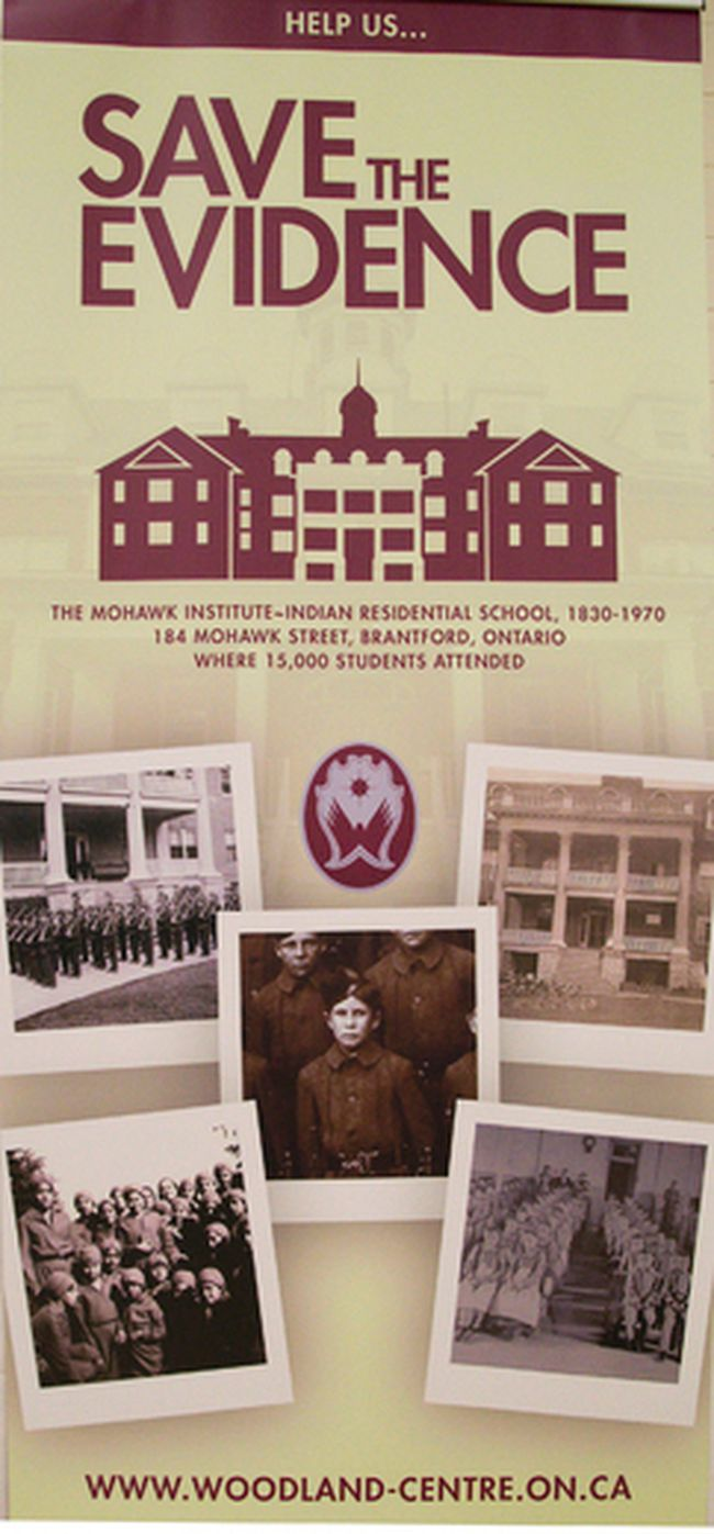 A banner shows images from the Mohawk Institute Residential School in Brantford. (Postmedia Network)