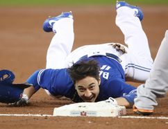 Darwin Barney of the Toronto Blue Jays crawls into third base after stumbling in the second inning during MLB action against the Baltimore Orioles at Rogers Centre on Sept. 11, 2017. (Tom Szczerbowski/Getty Images)