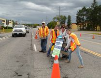 Photo by Patricia Drohan/For The Mid-North Monitor Michael Dunn, Terri Noble and some young volunteers worked the ERH Foundation, annual Labour Day toll on Highway 6 in Espanola, collecting donations for the nursing home park project.