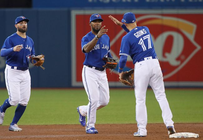 Teoscar Hernandez of the Toronto Blue Jays celebrates with Ryan Goins during MLB action against the Baltimore Orioles at Rogers Centre on Sept. 11, 2017. (Tom Szczerbowski/Getty Images)