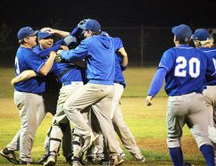 Stonewall Blue Jays player-manager Adam Kirk (second from left) celebrates with his teammates after the team won the 2017 Winnipeg Senior Baseball League championship with an 8-3 victory over the Elmwood Giants at Fines Field Sept. 12. (Adam Peleshaty/Stonewall Argus & Teulon Times/Postmedia Network)