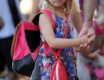 <p>A pupil holds the hand of her father in the courtyard at the Abbe de l'Epee elementary school on September 3, 2013 in Marseille, southern France.</p><p> ANNE-CHRISTINE POUJOULAT/AFP/Getty Images