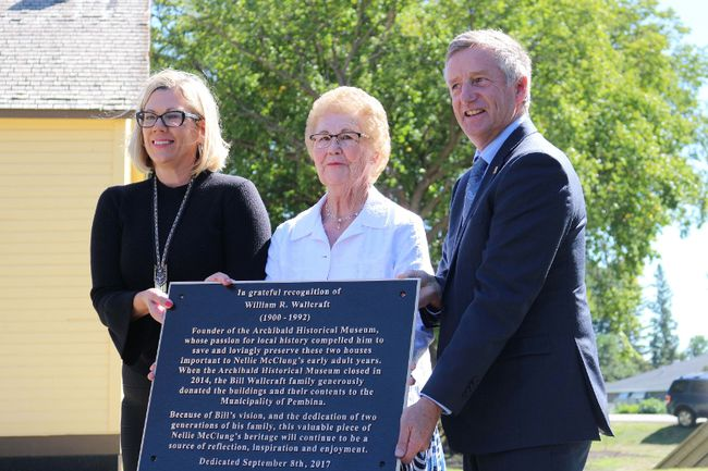 Minister of Sport, Culture and Heritage Rochelle Squires, Wilma Wallcraft and Minister of Infrastructure and MLA for Midlands Blaine Pedersen unveiled a plaque to honour William Wallcraft for preserving the buildings and donating them to the Municipality of Pembina. (LAUREN MACGILL, Morden Times)