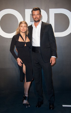 Singer Fergie and actor Josh Duhamel arrive at The Tom Ford Autumn/Winter 2015 Women's Wear Collection Presentation in Los Angeles, California, February 20th, 2015. AFP PHOTO / Valerie Macon (Photo credit should read VALERIE MACON/AFP/Getty Images)