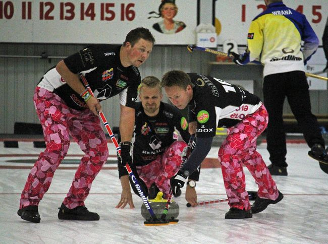 Lead Haavard Vad Petersson of Team Ulsrud from Norway makes the shot, during Shorty Jenkins action at the Cornwall Curling Centre on Thursday. At left is second Christoffer Svae, with third Torger Nergaard at right. Kevin Gould/Cornwall Standard-Freeholder
