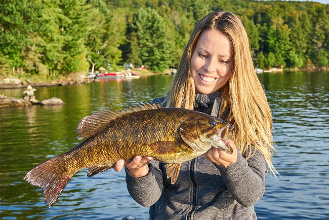 Columnist Ashley Rae with a smallmouth bass from Kashagawigamog Lake in Haliburton. (Submitted photo)