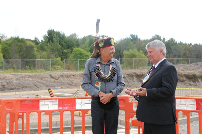 Darrell Boissoneau, of the Shingwauk Education Trust and Sault MP Terry Sheehan talk at the site of the new Anishinabek Discovery Centre currently under construction. The centre has received a total of $10.2 million in federal government funding.