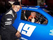 Stock car racer Parker Heard (left) of Tara and Adam Long donated Parker's $600 season earnings at the track to send a boy with autism and his family to camp.They posed at Sauble Speedway Sept.2. Submitted photo