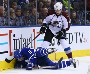 Zach Hyman of the Toronto Maple Leafs gets hit by Nikita Zadorov of the Colorado Avalanche at the Air Canada Centre in Toronto on Dec. 11, 2016. (Dave Abel/Toronto Sun/Postmedia Network)