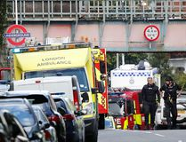Ambulances and police nearby after an incident on a subway train at Parsons Green subway station in London, Friday, Sept. 15, 2017. (AP Photo/Frank Augstein)
