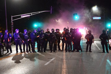 Law enforcement officers stand guard during a protest action following a not guilty verdict on Sept. 15, 2017 in St. Louis, Mo.  (Michael B. Thomas/Getty Images)