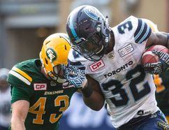 Toronto Argonauts running back James Wilder Jr. (right) is tackled by Edmonton Eskimos defensive back Neil King during the first half of CFL football action in Toronto on Saturday, September 16, 2017. THE CANADIAN PRESS/Chris Young