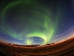 The northern lights form over lights trails from cars heading north on Highway 63 towards Fort McMurray, Alta. on Thursday, September 15, 2016. Robert Murray/Fort McMurray Today/Postmedia Network