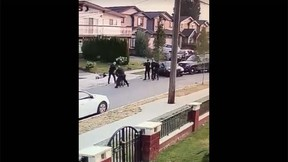 A video posted on Facebook shows an aggressive police takedown in Burnaby, B.C. (Facebook)