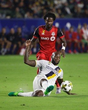 Los Angeles Galaxy's Michael Ciani (bottom) kicks the ball away from Toronto FC's Tosaint Ricketts during the first half of an MLS soccer match Saturday, Sept. 16, 2017, in Carson, Calif. (JAE C. HONG/AP)