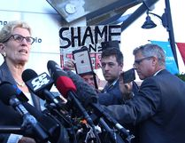 Premier Kathleen Wynne speaks to media at a courthouse in Sudbury, Ont. on Wednesday September 13, 2017. The premier was testifying at the trial of Pat Sorbara, her former deputy chief of staff and Liberal campaign director, and Gerry Lougheed, a local Liberal organizer, who are charged with bribery under the Election Act and both have pleaded not guilty. Gino Donato/Sudbury Star/Postmedia Network