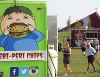 Visitors to Trenton's Centennial Park walk between several food trucks and booths at Food Trucks United presented by Hanon Systems Canada Inc.on Saturday September 16, 2017 in Trenton, Ont. The annual event is a fundraiser for the United Way Hastings and Prince Edward. Tim Miller/Belleville Intelligencer/Postmedia Network