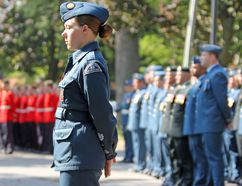 An air cadet stands in front of her contingent at the Battle of Britain parade at the RCAF Memorial in City Park on Sunday. (Steph Crosier/The Whig-Standard)