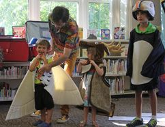Family entertainer Peter Puffin (Peter Lenton), left, performs at the Kingscourt library's Last Day of Celebrations on Saturday. (Steph Crosier/The Whig-Standard)