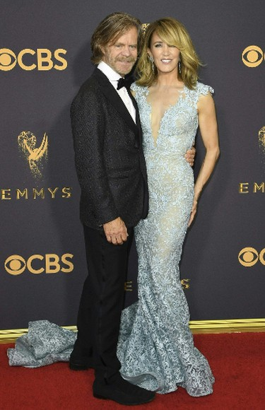 Felicity Huffman and William H. Macy arrive for the 69th Emmy Awards at the Microsoft Theatre on Sept. 17, 2017 in Los Angeles. (MARK RALSTON/AFP/Getty Images)