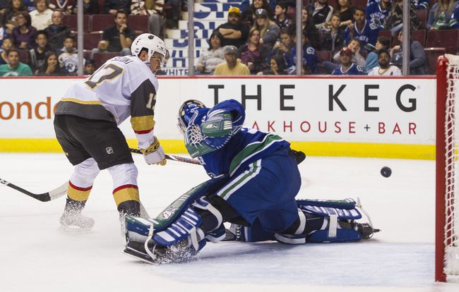 Nick Suzuki #17 of the Las Vegas Golden Knights puts a backhand shot past goalie Thatcher Demko #35 of the Vancouver Canucks in NHL pre-season action on September 17, 2017 at Rogers Arena in Vancouver, British Columbia, Canada. (Photo by Rich Lam/Getty Images)