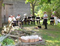 Members of Toronto's famous Hannaford Street Silver Band prepare to entertain a large audience on the grounds of the Macaulay House Museum in Picton Saturday afternoon.