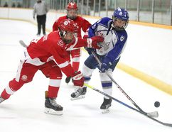 Gabriel Zimbranoof the Soo Greyhounds battles for the puck with Henri Lefebvre of the Sudbury Wolves during major peewee action at the NOHL AAA showcase weekend at the Gerry McCrory Countryside Sports Complex in Sudbury, Ont. on Sunday September 17, 2017. Gino Donato/Sudbury Star/Postmedia Network