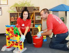 Farm Credit volunteers Hilary Pincombe and Ryan Clubb scrub down toys at the St. Clair Child and Youth Services Family Drop-In Centre as part of the United Way's Day of Caring on Sept. 12. CARL HNATYSHYN/SARNIA THIS WEEK