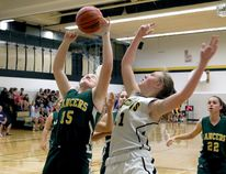Erica Terrell of the Loyalist Lancers goes up for a rebound against Bryn Reynolds of the La Salle Black Knights during senior girls basketball action at the Taylor Allan Memorial Tournament on Sept. 15 at La Salle Secondary. The Kingston Area senior girls season tips off Tuesday. (Ian MacAlpine, The Whig-Standard)