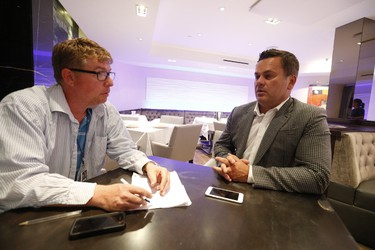 """Michael Dabic (R) owner of Michael's on Simcoe - a high-end steak house - speaks with Joe Warmington about the alleged """"hit"""" that took place on Saturday evening just before 9 p.m. killing Simon Giannini September 18, 2017. (Jack Boland/Toronto Sun)"""