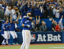 Jose Bautista of the Toronto Blue Jays hits a three-run home run against the Texas Rangers in Game 5 of the American League Division Series in Toronto on Oct. 14, 2015. (Stan Behal/Toronto Sun/Postmedia)