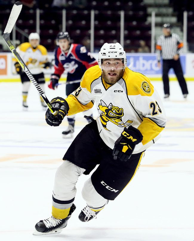 Sarnia Sting's Curtis Egert (23) plays against the Windsor Spitfires during an OHL exhibition game at Progressive Auto Sales Arena in Sarnia, Ont., on Saturday, Sept. 16, 2017. (Mark Malone/Chatham Daily News)
