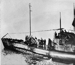 In this undated photo people stand on the deck of a World War I German submarine type UC-97 in an unknown location. (AP Photo, File)