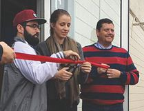 Bretton Selent (left) and his wife Lindsay (middle) cut the ribbon with the aid of city manager Jean-Marc Nadeau (right) at their grand opening Saturday in Portage. It's the second Dance Studio in Portage la Prairie. (Submitted photo)
