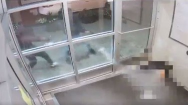 Two gunmen are seen firing through glass at Anthony Soares on Sept. 14, 2017.