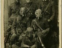 Petrolia's Major Charles Fairbank poses with a group of soldiers wearing gas masks in Steenvoorde, France on Aug. 24, 1916. Handout/Sarnia This Week