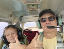 COPA Kincardine Flight 172 is offering reserved flights to young people aged eight to 17 during a four-hour event on Sept. 23, 2017. Pictured: Pilot Garry Shepherd gives a thumbs up with his 10 year old daughter.