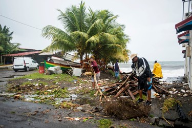 People clear debris in Saint-Pierre, on the French Caribbean island of Martinique, after it was hit by Hurricane Maria, on September 19, 2017. Martinique suffered power outages but avoided major damage. / AFP PHOTO / Lionel CHAMOISEAULIONEL CHAMOISEAU/AFP/Getty Images