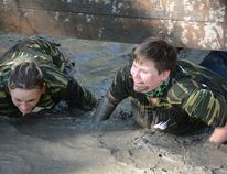 Participants laugh as they crawl through the mud during the Big Bang Mud Run on Sept. 16 (Peter Shokeir | Whitecourt Star).