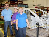 Martinrea Ridgetown celebrated its 30th anniversary on Saturday. From left are general manager Don Gillier, production supervisor Deborah Langham, and Ruth Roos, of human resources. They're standing in front of a frame for the Chevrolet Bolt, a fully electric vehicle. Next year, the company will begin supplying parts for driverless vehicles.