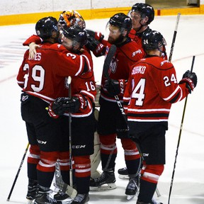 Members of the Owen Sound Attack comfort each other after being eliminated from the Ontario Hockey League's Western Conference final playoff series by the Erie Otters in April 2017. (Denis Langlois, Postmedia Network)