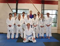 "Huron BJJ Head Instructor Shaun Gregory (in front) poses with his students at WorkHorse Strength and Conditioning gym in Clinton before last Wednesday night's class. Gregory says his students, who range in age and skill level, are ""pumped"" for November's tournament after months of not being able to compete at events. Back row (left to right): Jeff Cera, Cody Fischer, Joel Belcourt, Matt Elligson. Front row (left to right): Mike Dale, Mike Morrison, Allison Elligson, Madelynn VanLaar, Victoria Howard, Jenn Fleming."