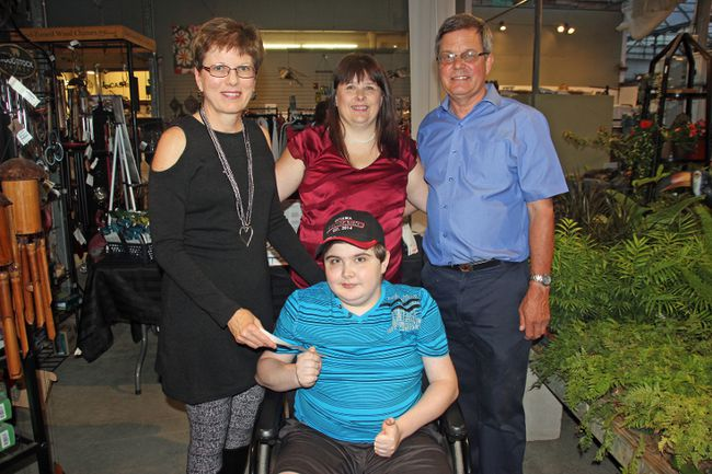 Sunset Nursery presented a cheque of $3139 to Colby's Crusade prior to their Karisma Fall Fashion Show on Sept. 20. The funds were raised through the sale of the clothes at Karisma Fashion Boutique over the past two months. Pictured here (from left) are Cathy Hugli, Gloria Audette, Ross Hugli and Colby Audette (in front).