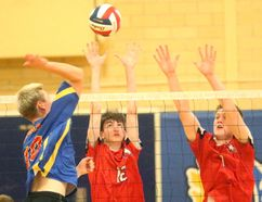 Oakridge's Luke Blissett who played for the National team's U17 squad this summer hits into the block of Medway's Rory Welch and Lucas Bycraft during their season opening match at Oakridge on Wednesday September 20, 2017. The Oaks won 25-16, 27-25 and 25-17 as the Cowboys showed they were not going to go quietly this season. Mike Hensen/The London Free Press/Postmedia Network