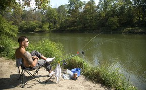 Alex Balog of London thought the warm weather Wednesday was a perfect day to do a little catch and release fishing on the Thames River near the Kilworth Bridge in London, Ont. Photograph taken on Wednesday September 20, 2017. (MIKE HENSEN, The London Free Press)