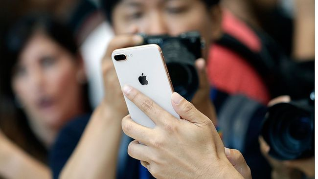 The new iPhone 8 Plus is displayed in the showroom after the new product announcement at the Steve Jobs Theater on the new Apple campus on Tuesday, Sept. 12, 2017, in Cupertino, Calif. (AP Photo/Marcio Jose Sanchez)