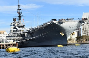 Speed boaters get a thrill riding beneath the bow of the giant aircraft carrier USS Midway. It?s the length of three football fields and served from 1945 to 1992. It is now a museum, docked in San Diego Bay. (BARBARA TAYLOR, The London Free Press)